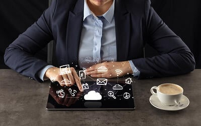 Business woman working on tablet with application and cloud technology concept
