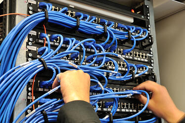 Man installing structured IT cabling system