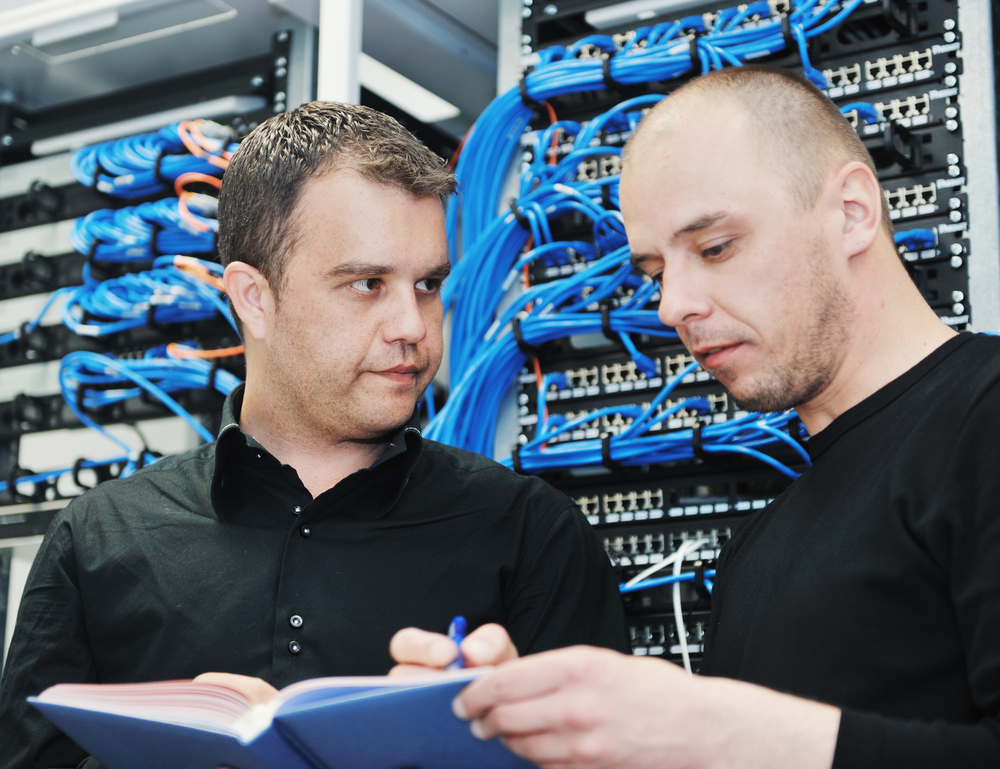 it engineer in network server room solving problems and give help and support
